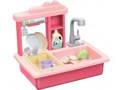 Dřez na mytí nádobí růžový a kohoutek na vodu na baterie