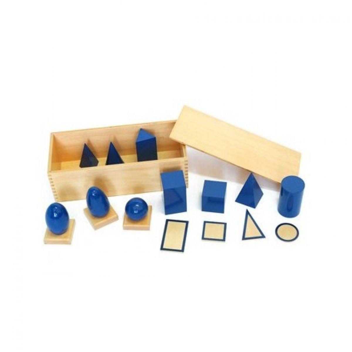 Montessori Geometrická tělesa s podstavci a krabicí